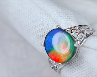 Rare grade AA one of a kind ammolite in a sterling silver ring setting.