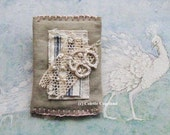 Textile brooch, pin back, handmade, embroidery, old ticking and lace