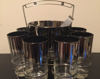 Dorothy Thorpe silver rimmed glasses and ice bucket in caddy set