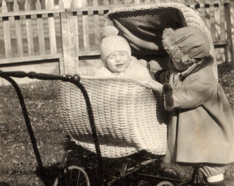 vintage photo Little Girl Reaches in To Love Baby Girl in Wicker Buggy