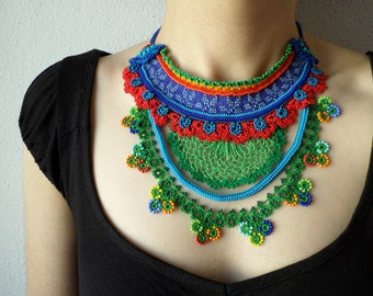 colorful freeform crochet bib necklace -  statement necklace with red, cornflower blue and green beaded crochet flowers
