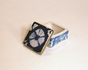 tiny cobalt blue porcelain box with underglaze decoration and 22k gold luster
