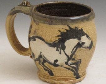 Mug with horses slip trailed  pottery