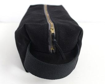 Black canvas toiletry bag.