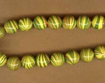 vintage japanese beads, swirly plastic coated beads 1960s extreme retro beads YELLOW beads with orange and green swirls TWENTY FIVE beads