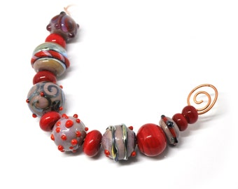 Set of purple and red lampwork beads