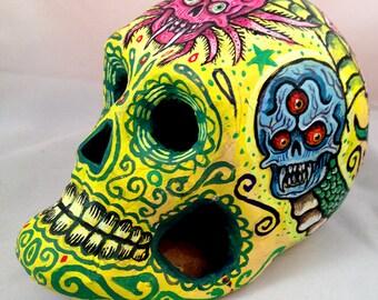 Yellow Hand Painted Dia De Los Muertos paper Mache Baby Skull by Michael Brown/UC Studios