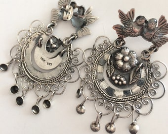 Frida Kahlo style earrings, lovebirds, flower and leaves surrounded by filigree, fringed with silver balls.