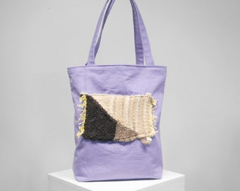 Handmade tote bag with handwoven patch