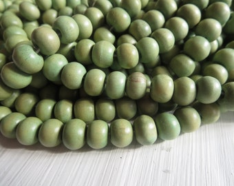 green round wood beads , painted light green , finished wood , small round wooden bead, exotic natural material Indonesian 50 beads  5A22-3