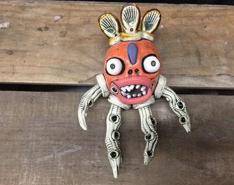 Octopus sculpture, wall hanging, ceramic sculpture