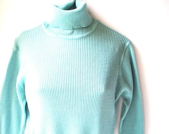Classy vintage 70s pastel mint acrylic, ribbet knit, stretched  sweater turtle neck.  Made by Mardi. Size M- L.