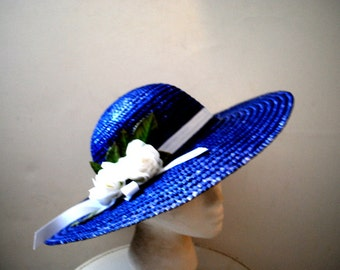 Classy vintage 80s navy blue  straw hat with a wide sturdy bream and white roses. Size 21