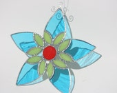 Blue and lime green stained glass flower with red centre window catcher ornament