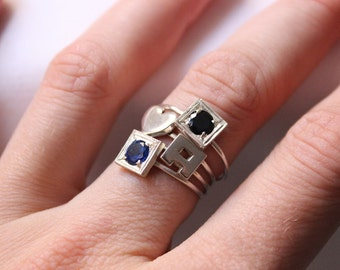 Stackable Birthstone Initial Ring Set of 4 Rings in Sterling Silver. Each birthstone and initial represents a child.