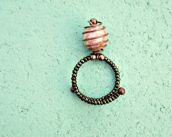 Beaded Adjustable Iridescent Brown Memory Wire Ring with Caged Glass Focal Bead: Curlicue
