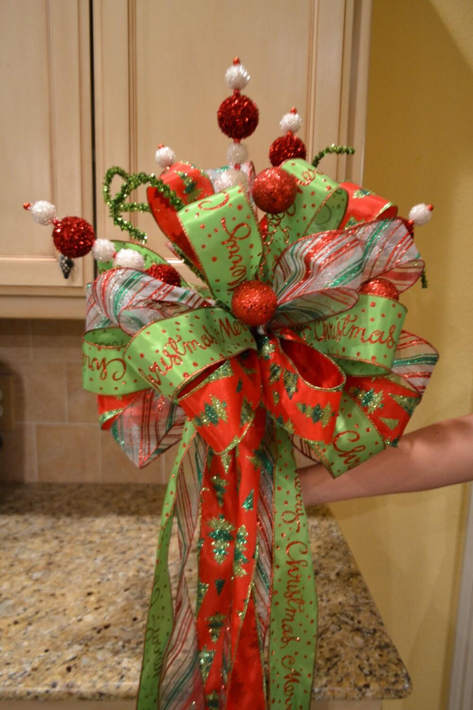 Christmas tree ribbon topper with glitter balls