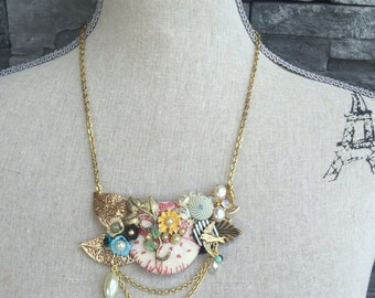 A little mixed up colage necklace