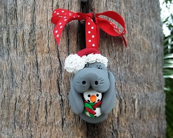 Santa Manatee with Snowman Ornament