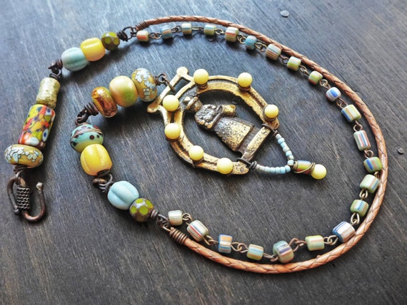 The Coming Day. Colorful necklace with chunky art beads and horse brass.
