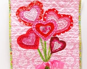 "Valentine wall quilt - bouquet of heart flowers tied with satin ribbon -in red, pink and green on pink ""For You"" READY TO SHIP"