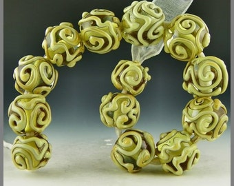 set of 13 rounds in pale amber with river rock ivory stringer designs handmade lampwork glass beads - Golden Lace