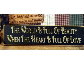 The world is full of beauty when the heart is full of love primitive sign