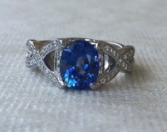 Engagment Ring 2.32 Carat Oval Blue Natural Sapphire and Diamond Criss Cross Design