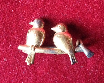 Two birds brooch