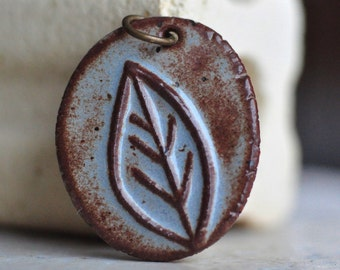 Azure Blue and Sepia Leaf ceramic pendant, handcarved from stoneware clay by Artgirl56