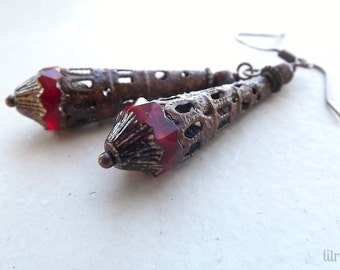 Dangle earrings with beautiful red Czech glass beads and rusty metal cones