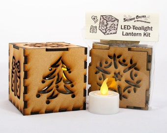Winter holiday 3-inch laser cut cube kit featuring Snowflake, Christmas Tree, Snowman, Present, and Mitten Cutout Designs