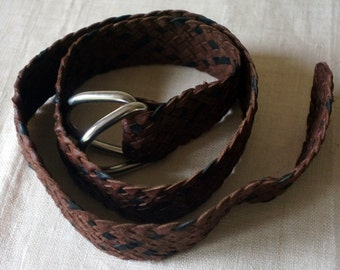 Hand plaited kangaroo skin belt in black and brown with silver ring closure