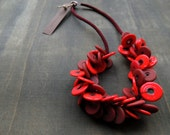 Firered and winered glass circles combined with crochet tubes