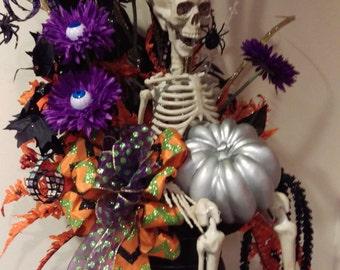 Whimsical Tabletop Skeleton Halloween Arrangement