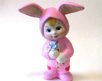 """Bunny 7 1/2"""" bunny kid dressed in pink and holding a flower"""