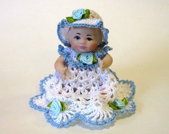 "Bye lo 5"" cast in porcelain from Grace Story Putman mold dressed in blue and white christening dress"