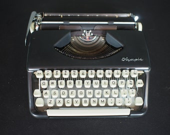 Olympia SF Black Typewriter w/ Ribbon, instructions and Case