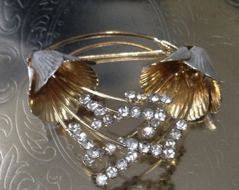 Silver and gold pin brooch with rhinestones