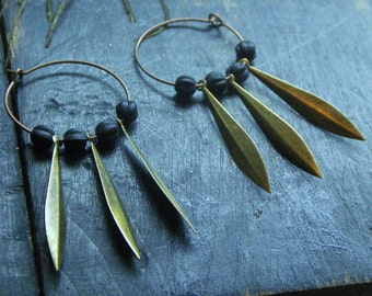 Daggerhorn. Brass dagger and black carved wood soft grunge hoop earrings Boho Grunge earrings.