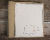 handmade linen album with hand-embroidered wool felt patch: bear by kata golda