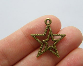 8 Star charms antique bronze tone BC133