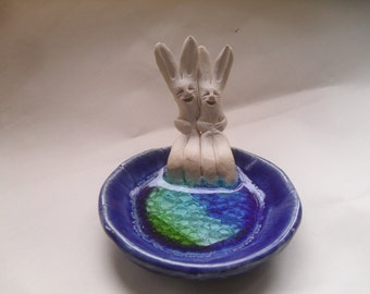 Rabbit Couple with Toes in Pool of Water