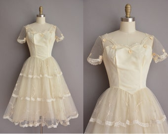 50s ivory lace tea length vintage wedding dress / vintage 1950s wedding dress