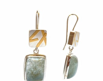 Two pieces Sterling silver earrings with green rutilated quartz and gold details