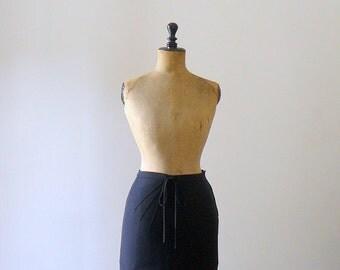 40% OFF SALE // Vintage black miniskirt. 1980s wool knit mini skirt