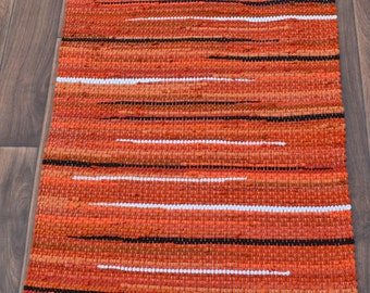 Handwoven Rug - 26x46 woven from Recycled T Shirts: Bright Orange, Brown, White.  Washable & Reversible
