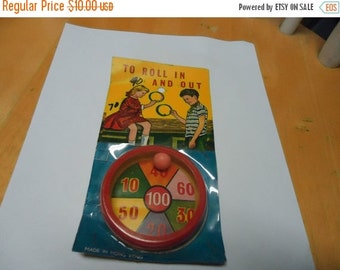 Independence Day Sale Vintage 1950's To Roll In And Out Toy Game in package, collectable, has ball