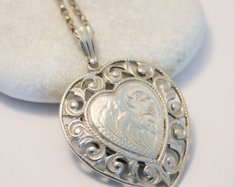 Vintage silver locket.  Sterling silver heart locket.  Back opening locket