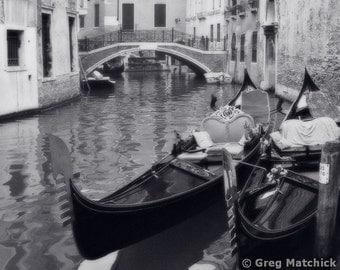 Fine Art Black & White Travel Photography of Two Docked Gondolas in Venice Italy